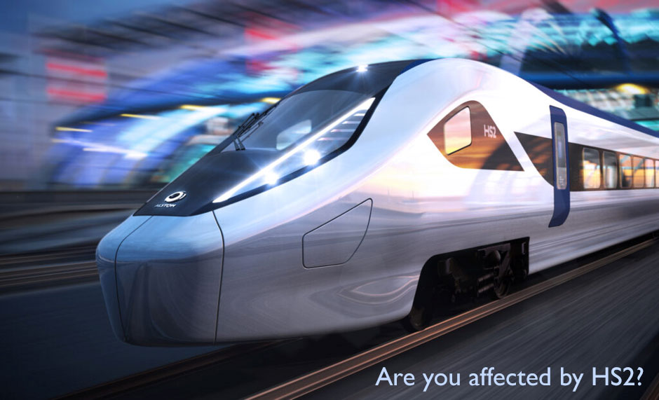 train rushing through a station